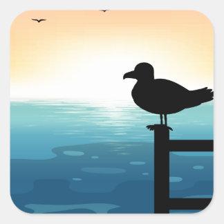 Sihouette bird at sea square sticker
