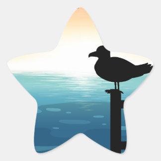 Sihouette bird at sea star sticker