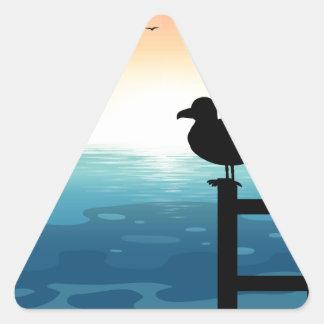 Sihouette bird at sea triangle sticker