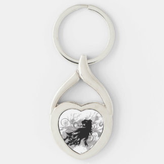 Silhouette, black lion head with flames keychain