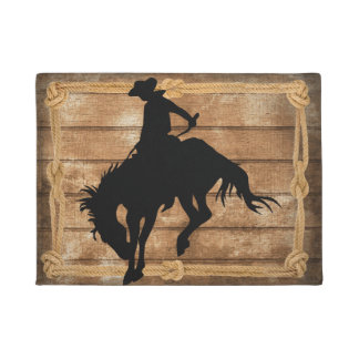 Silhouette cowboy on a bucking bronco horse doormat