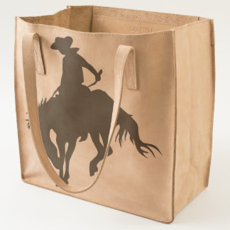 Silhouette cowboy on a bucking bronco horse tote