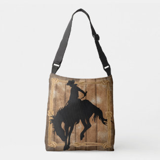 Silhouette cowboy on a bucking bronco horse tote bag
