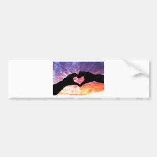 Silhouette hand in heart shape and beautiful sky car bumper sticker