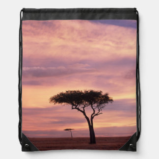 Silhouette image of acacia tree at sunrise drawstring bags