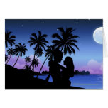 Silhouette of a couple embracing on the beach cards