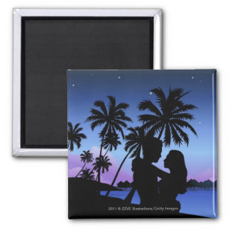 Silhouette of a couple embracing on the beach refrigerator magnets