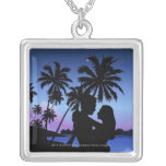 Silhouette of a couple embracing on the beach necklaces