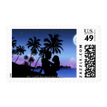 Silhouette of a couple embracing on the beach stamps