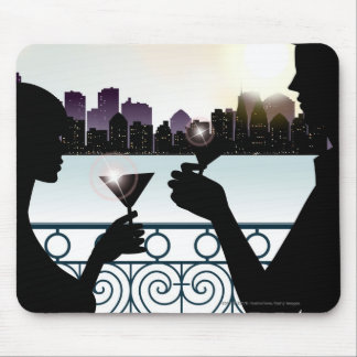 Silhouette of a couple toasting martini glasses mouse pad