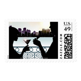 Silhouette of a couple toasting martini glasses postage