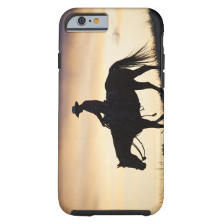 Silhouette of a Cowgirl on her horse against the Tough iPhone 6 Case