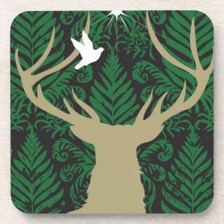 Silhouette of a deer, a dove and a star against a beverage coaster