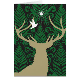 Silhouette of a deer, a dove and a star against a card