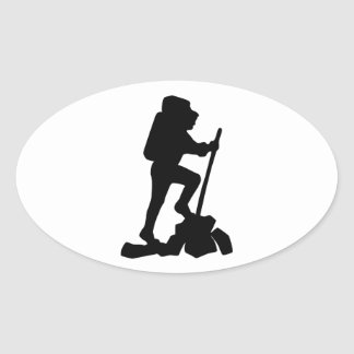 Silhouette of a Hiker Hiking Up a Mountain Oval Sticker