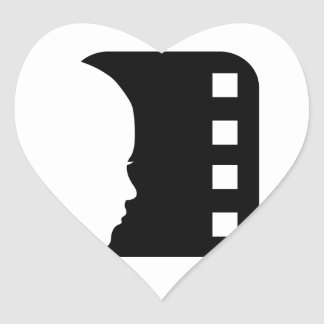 Silhouette of a lady's face on a filmstrip sticker