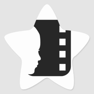 Silhouette of a lady's face on a filmstrip star sticker