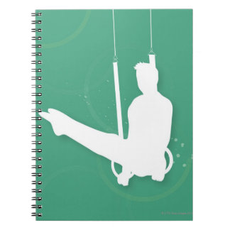 Silhouette of a man performing gymnastics spiral notebook