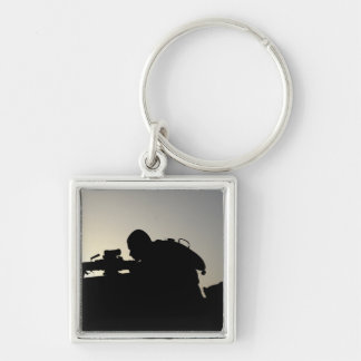 Silhouette of a Squad Automatic Weapon gunner Silver-Colored Square Keychain