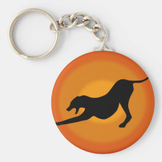 Silhouette of a Stretched Dog on Orange Background Keychain