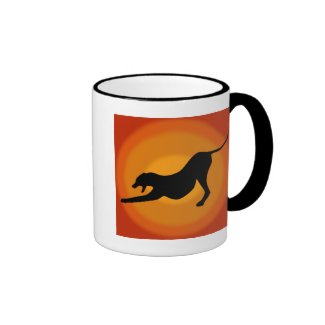 Silhouette of a Stretched Dog on Orange Background Coffee Mugs