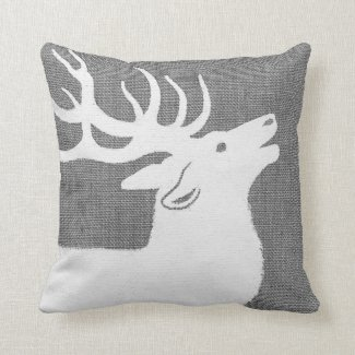 Silhouette of a white elk on a soft grey bckgrnd throw pillow