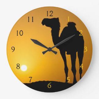Silhouette of a wild camel at sunset large clock