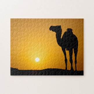 Silhouette of a wild camel at sunset puzzle