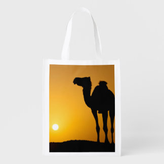 Silhouette of a wild camel at sunset reusable grocery bag