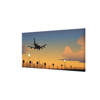 Silhouette of an airplane in flight canvas print