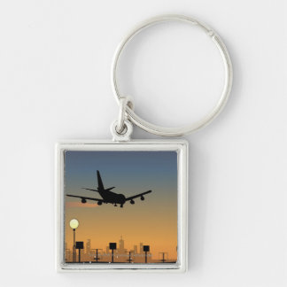 Silhouette of an airplane in flight keychain