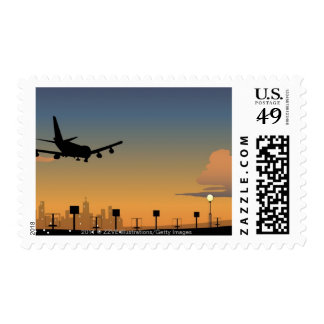 Silhouette of an airplane in flight postage stamp
