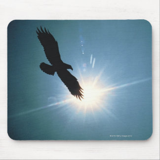 Silhouette of bald eagle flying in sky mouse pad