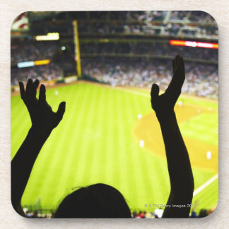 Silhouette of Baseball fan waving hands in the Coasters