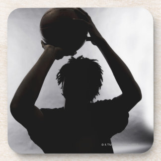 Silhouette of basketball player beverage coaster