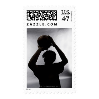 Silhouette of basketball player postage