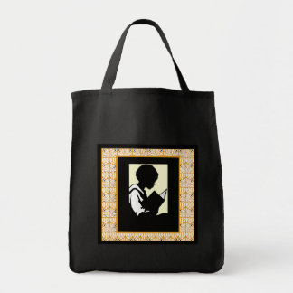 Silhouette of boy reading bags