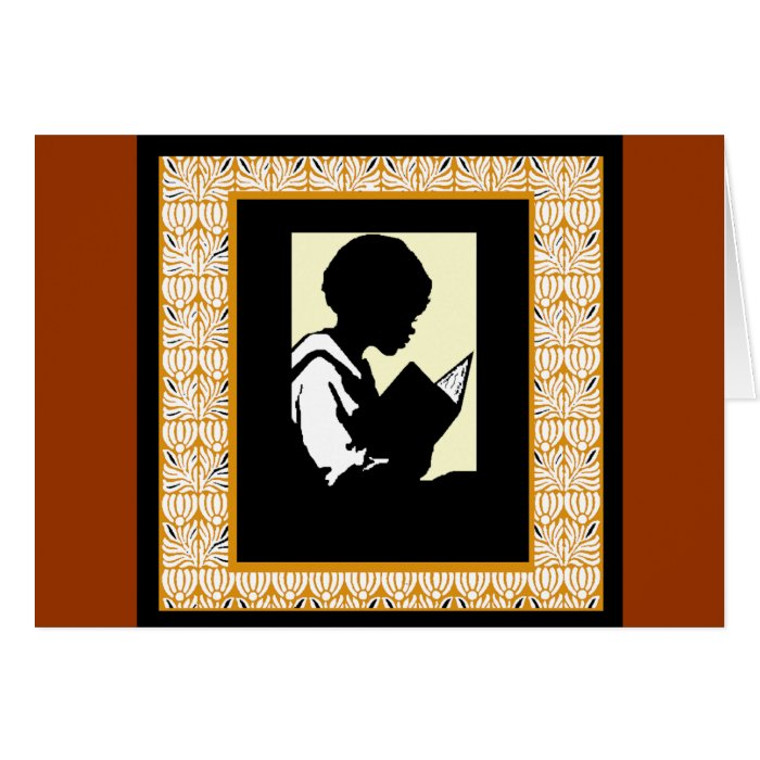 Silhouette of boy reading card