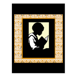 Silhouette of boy reading postcard