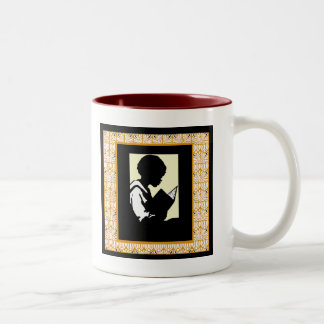 Silhouette of boy reading Two-Tone coffee mug