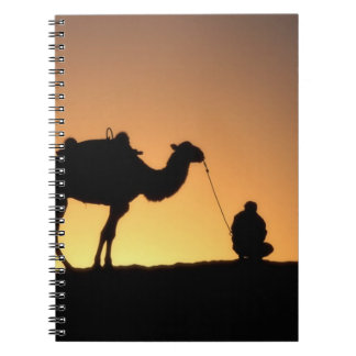 Silhouette of camel caravan on the desert at 2 spiral notebook