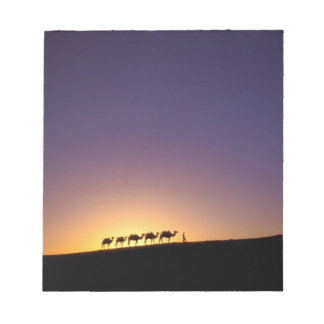 Silhouette of camel caravan on the desert at notepad