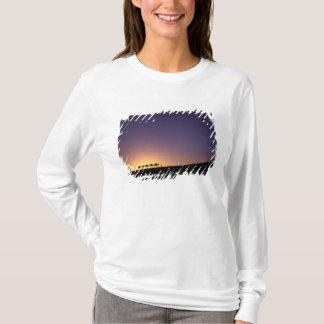 Silhouette of camel caravan on the desert at T-Shirt