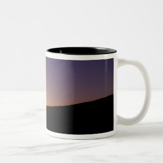 Silhouette of camel caravan on the desert at Two-Tone coffee mug