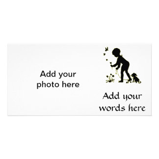 Silhouette of child picking flowers with dog card
