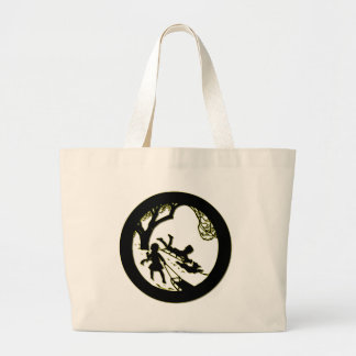 Silhouette of children sledding with their dog large tote bag
