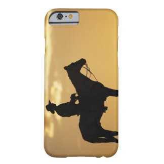 Silhouette of cowboy on horseback at sunset or barely there iPhone 6 case