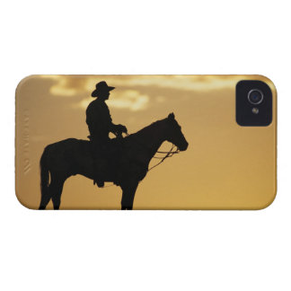Silhouette of cowboy on horseback at sunset or iPhone 4 case