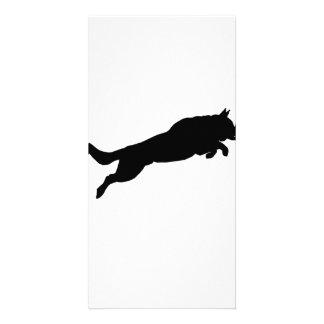 Silhouette of German Shepherd Dog Jumping over Card