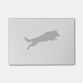 Silhouette of German Shepherd Dog Jumping over Post-it® Notes
